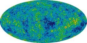 """WMAP – radiația relicvă a Universului. Diferențele de culoare din imaginea de mai sus  ne arată că densitatea și temperatura Universului primordial nu erau constante. Regiunile de culoare rosie sunt zone de densitate mai mare, """"semințele"""" viitoarelor roiuri de galaxii. Foto: NASA / WMAP Science Team"""