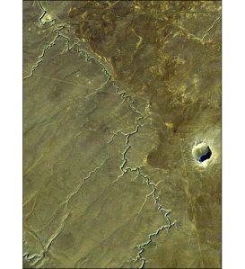 Craterul Barringer. S-a format când un obiect de 50 m s-a ciocnit cu planeta noastră, acum 50.000 de ani. Foto: Jet Propulsion Laboratory